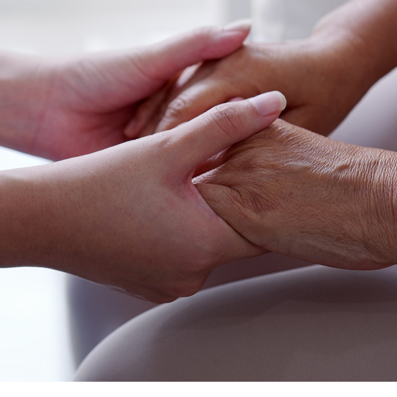 Young person holding old person's hands