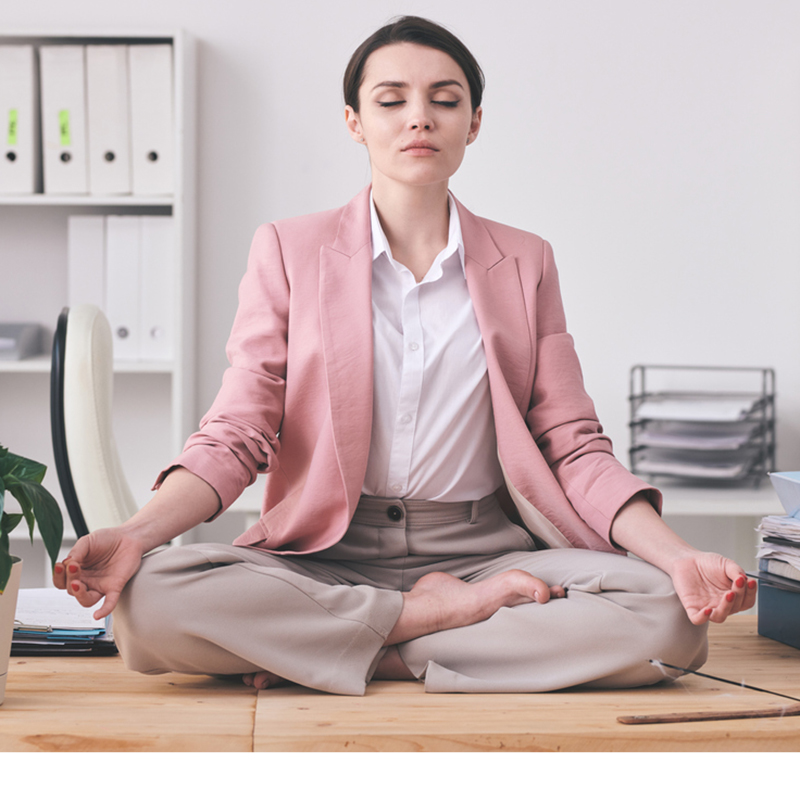 Woman meditating in the office