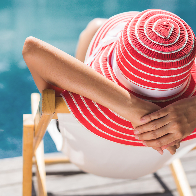 A woman relaxing by the pool in spa