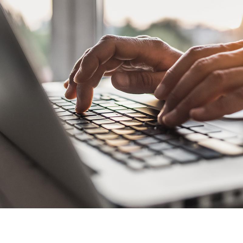 Close up of someone using laptop's keyboard
