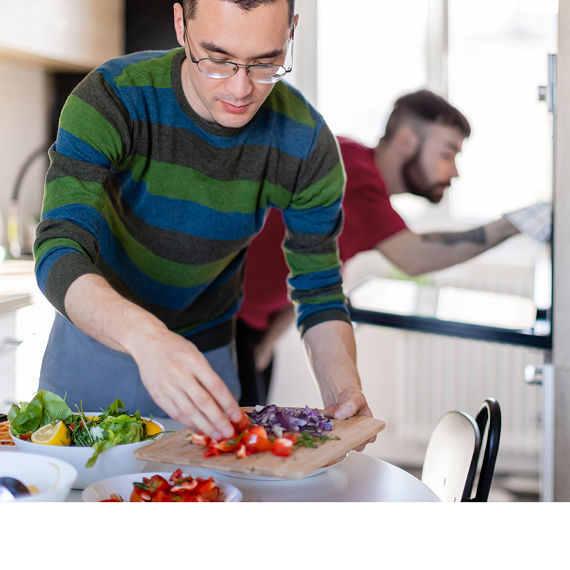 Young adults preparing food in the kitchen