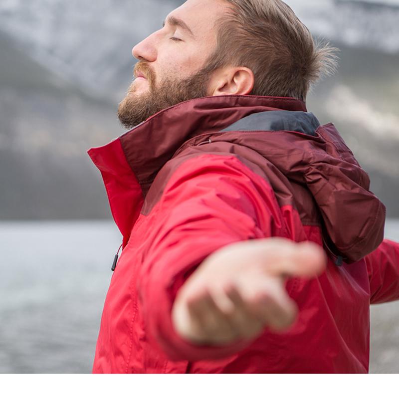 A man outside taking a deep breath of fresh air
